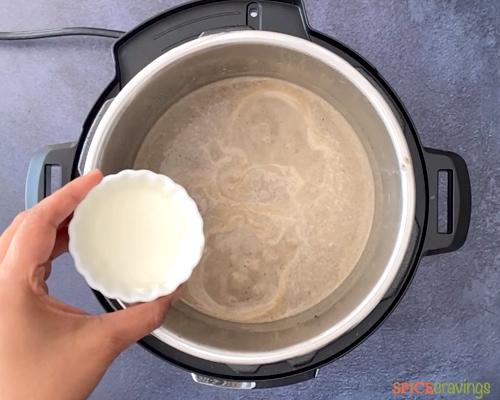 Adding cornstarch slurry to thicken the soup