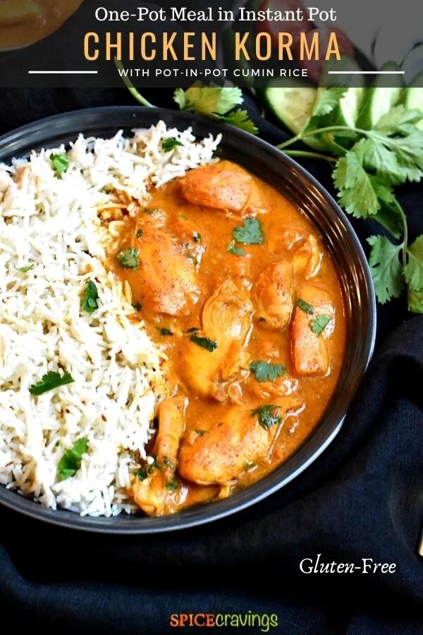 instant pot chicken korma with cumin rice in black bowl with fresh cilantro