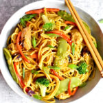 A bowl of Chicken Lo Mein served with a set of chopsticks