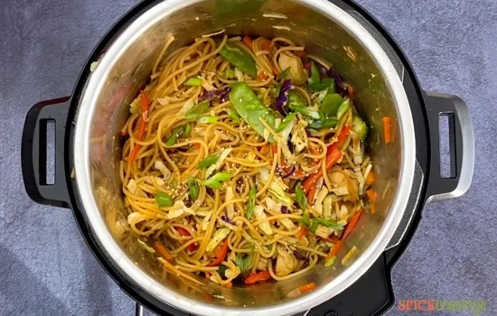 A pot full of chicken lo mein