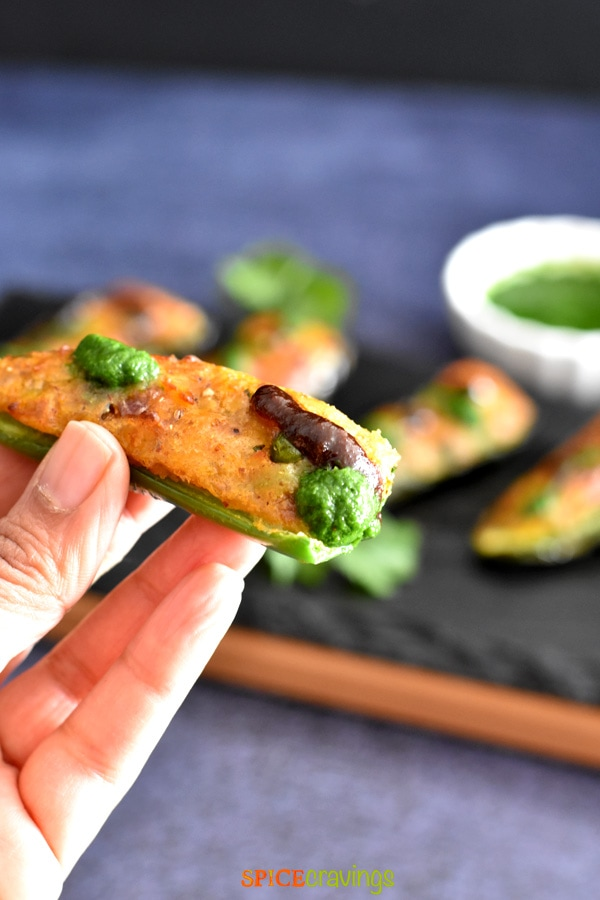 hand holding jalapeno pepper stuffed with samosa filling