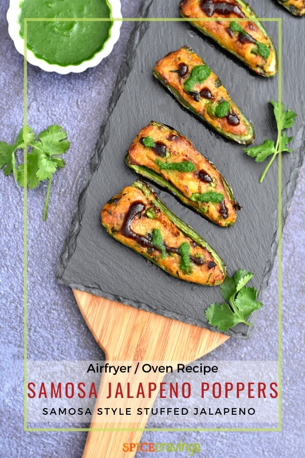 stuffed jalapeno peppers on charcoal board with cilantro chutney in small white bowl