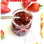 3-ingredient strawberry jam in glass jar with silver spoon and fresh strawberries