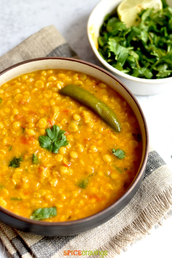 easy split lentil curry with green chili in bowl with fresh cilantro