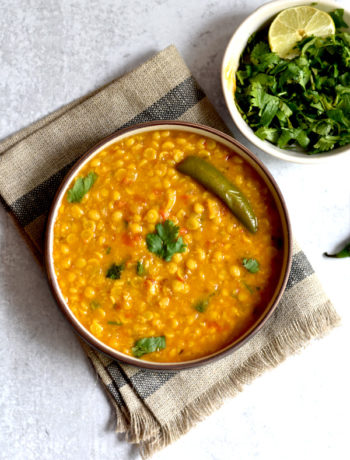 instant pot Indian chana dal with green chili in bowl with fresh cilantro on side