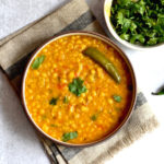 split chickpea curry in white bowl