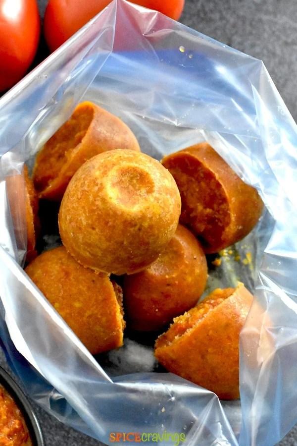 frozen portions of tikka masala sauce in plastic storage bag