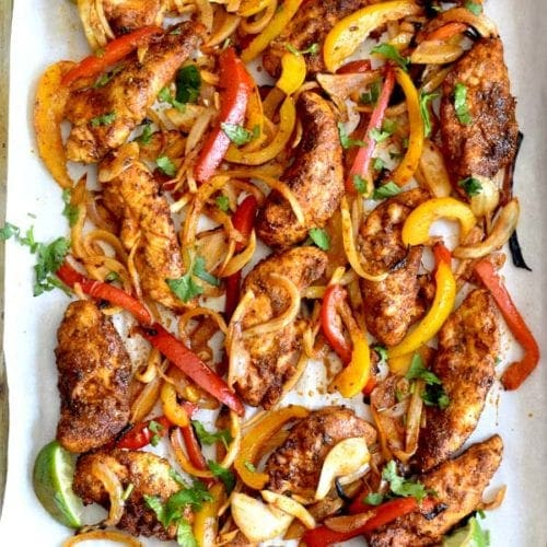 easy chicken fajitas recipe on parchment lined sheet pan