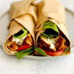 chicken shawarma with lettuce, tomato and tzatziki in wrap