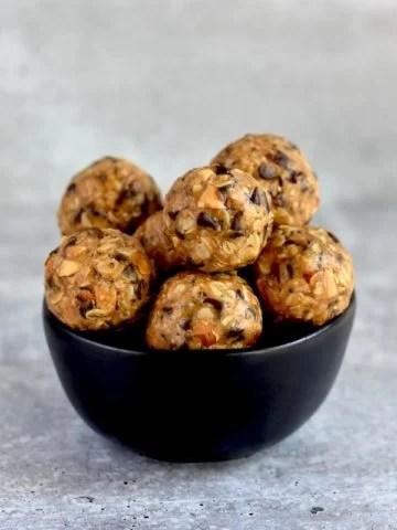 peanut butter oat protein balls in black bowl