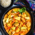 easy Thai red curry in black bowl with side of rice