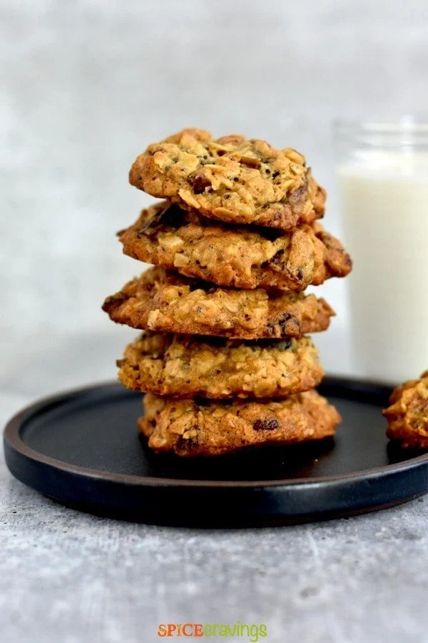 stack of soft and chewy cookies with glass of milk