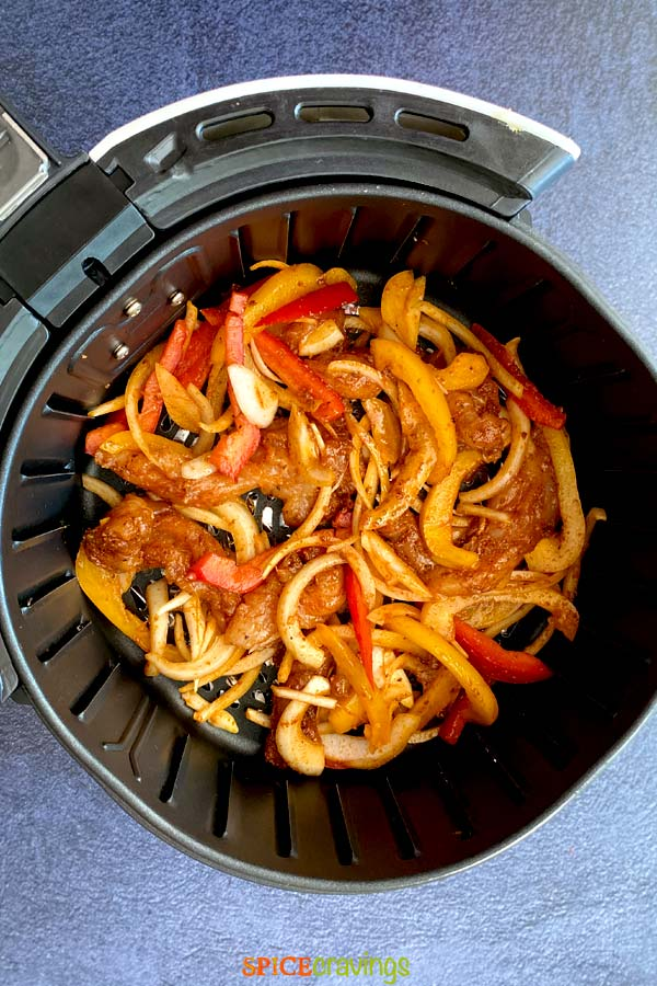 mexican seasoned chicken and vegetables in air fryer basket