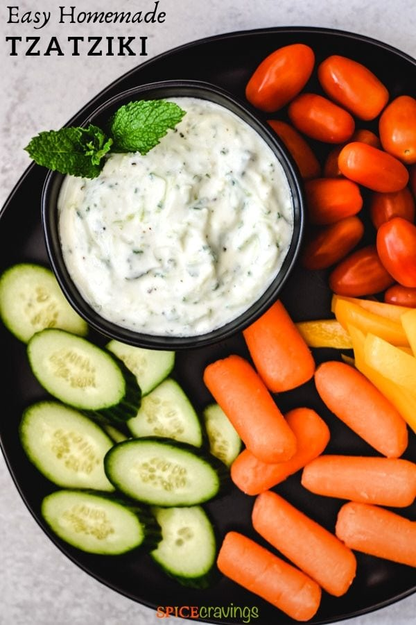 Greek tzatziki sauce recipe in black bowl with fresh vegetables pinterest graphic