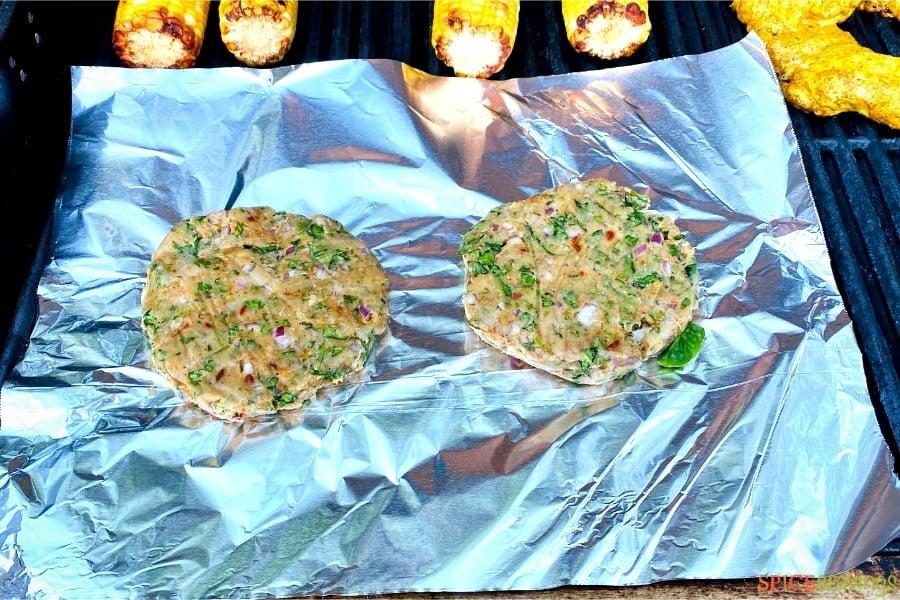 two masala chicken patties on aluminum foil