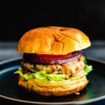 Indian chicken burgers with tomato and grilled onion