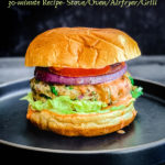 chicken burger with tomatoes and grilled onion