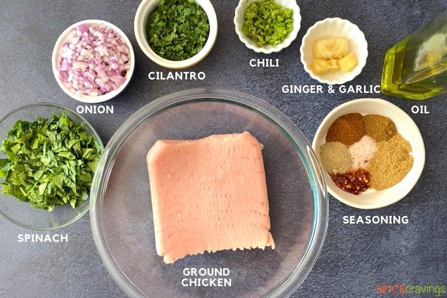 ground chicken, chopped spinach, red onion, cilantro, chili, ginger, garlic, spice seasoning in bowls