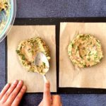 spoon shaping spiced chicken burgers on parchment paper liners