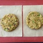 two round taco burger patties on parchment paper squares on cutting board