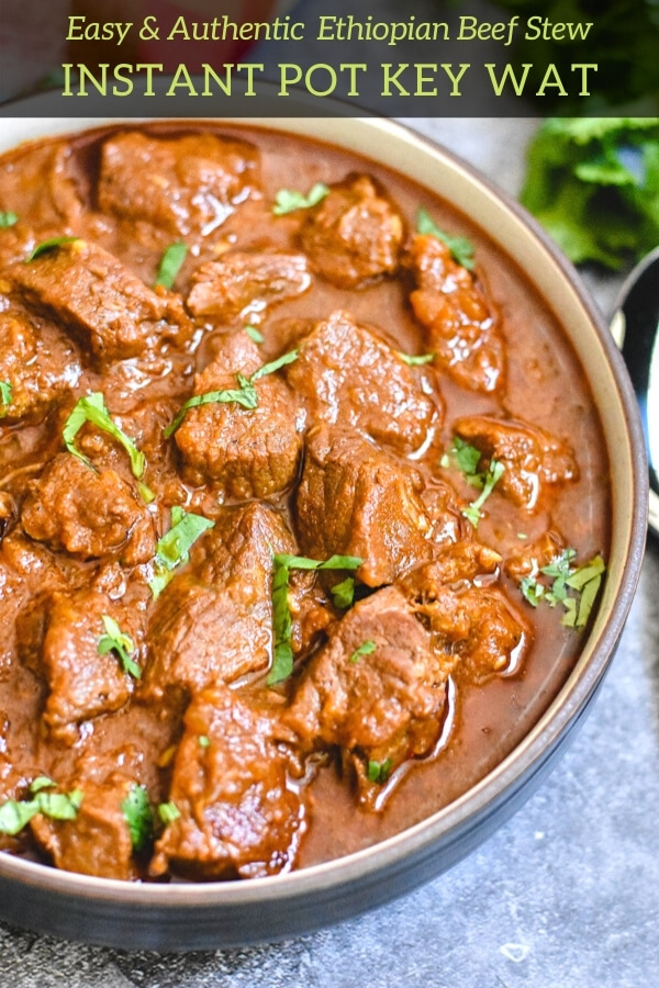 A close up shot of beef stew meat in a clay bowl