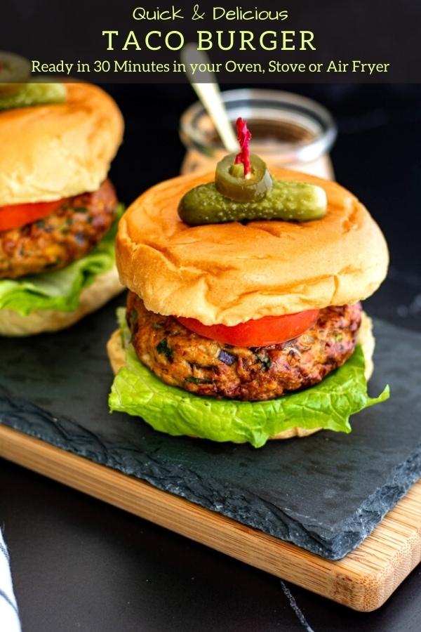 easy taco burger recipe with bun, lettuce, tomato, pickle