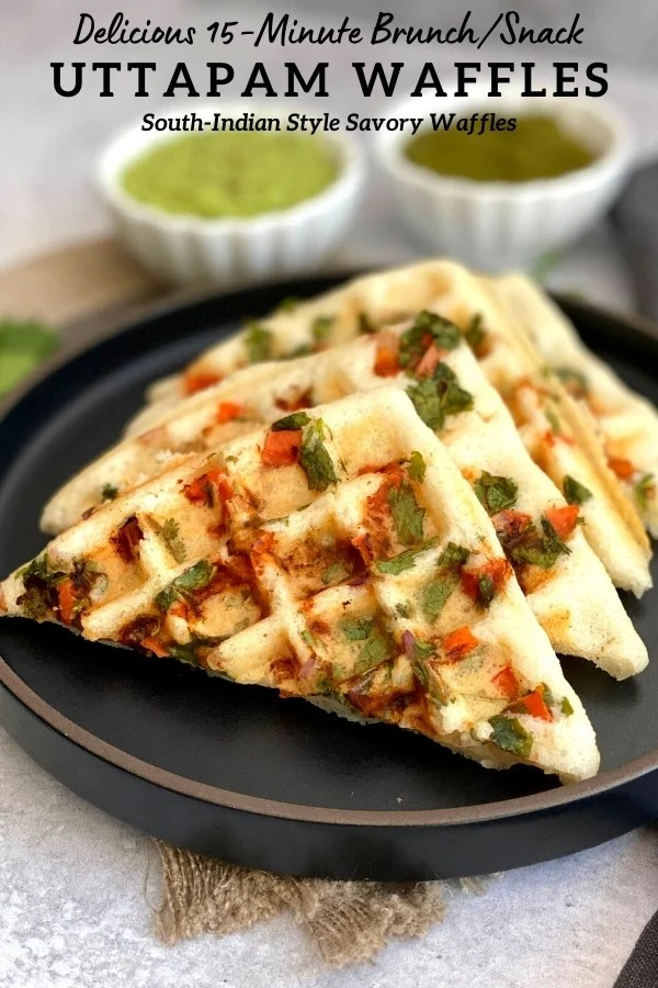 savory indian waffles on black plate with two bowls of chuteny on side