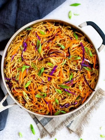 vegetable chow mein recipe in chef pan with towel