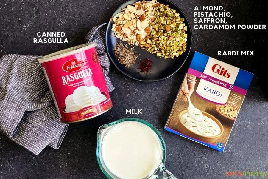 milk, canned rasgulla balls, saffron, cardamom, chopped almonds and pistachios, instant rabdi mix