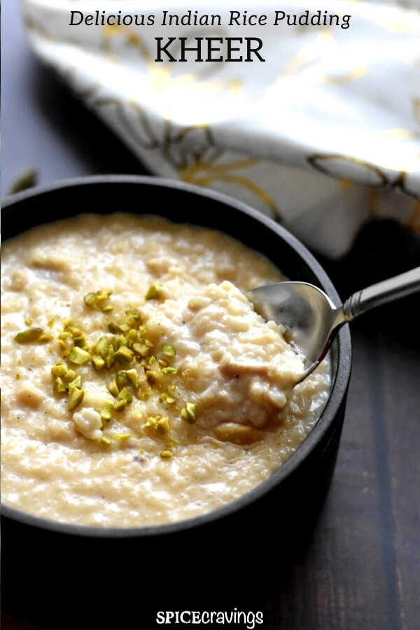 A bowl of Indian rice pudding with chopped pistachios on top