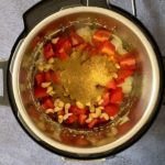 tomatoes, onions, cashews and Indian spices sauteing in instant pot