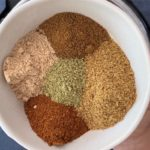 mix of indian spices in white bowl