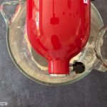 water pouring into bowl of red stand mixer