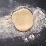bhatura dough on lightly floured surface