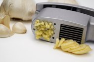 The Ultimate D&G garlic press AND slicer in ONE. Crush AND Slice effortless! Cleaning tool included!