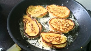 Fry fritters until golden brown on the bottom then flip over and fry in the same manner.