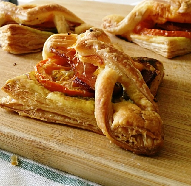Bacon Pesto Pastries on a cutting board