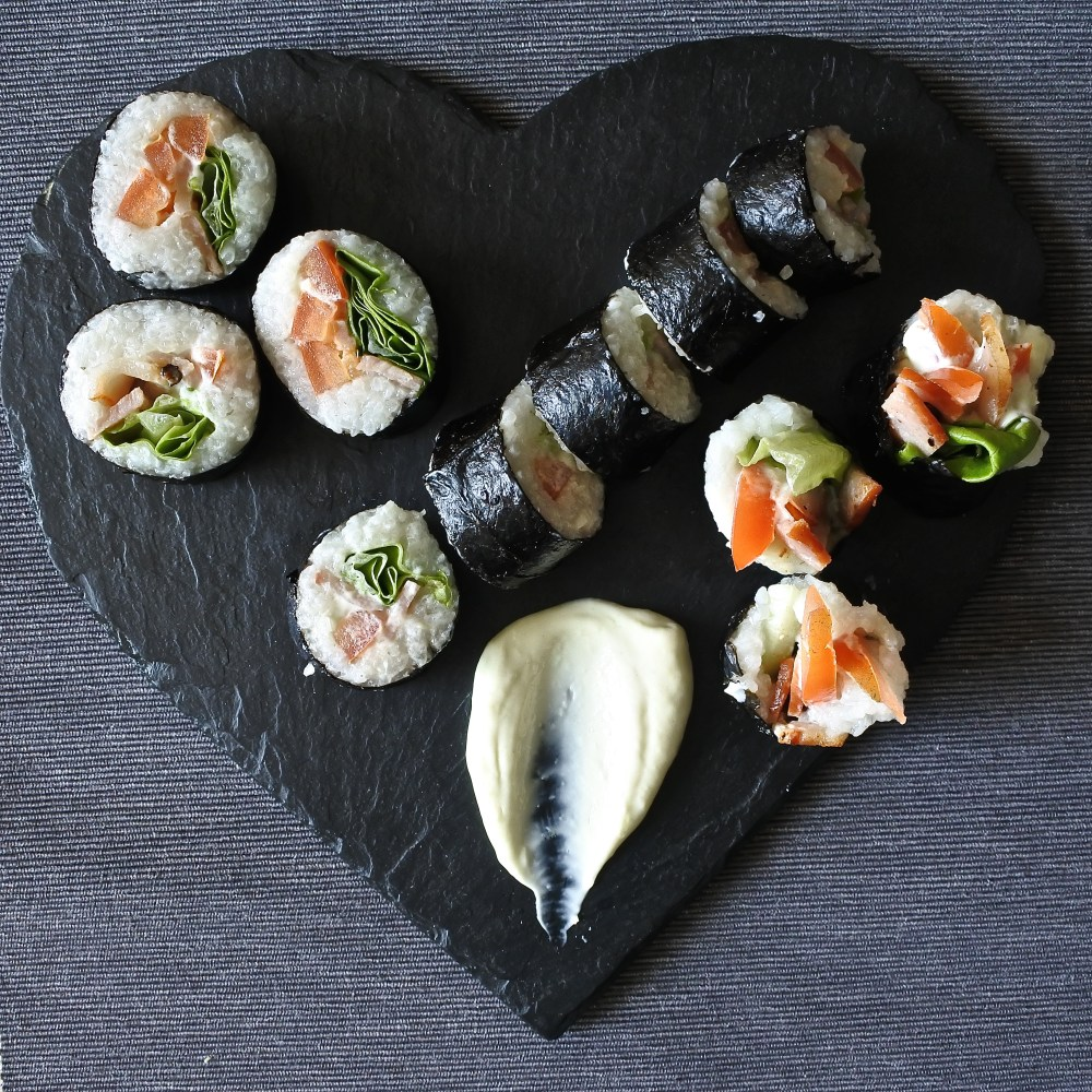 BLT sushi rolls on heart shaped slate with wasabe mayo