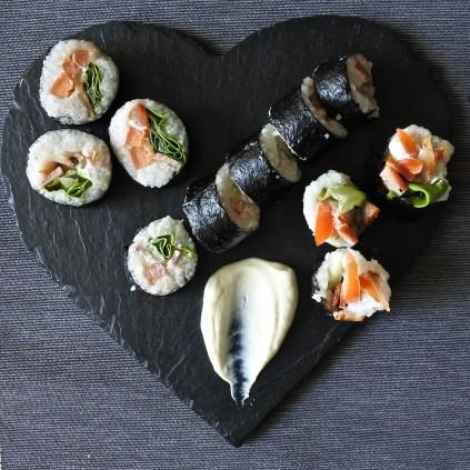 blt sushi rolls on heart shaped slate with wasabe mayo