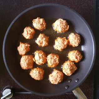 Add oil to a medium non-stick frying pan and heat over medium high heat. When oil is hot, add carrot bhaji balls and fry until crispy on both sides. Take out and drain excess oil on paper towels and sprinkle with freshly cracked black pepper. Serve with a yogurt dipping sauce.