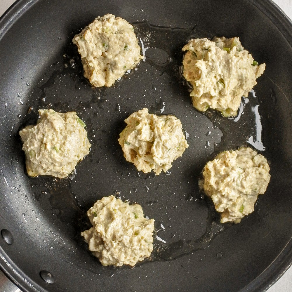fritters frying in a pan