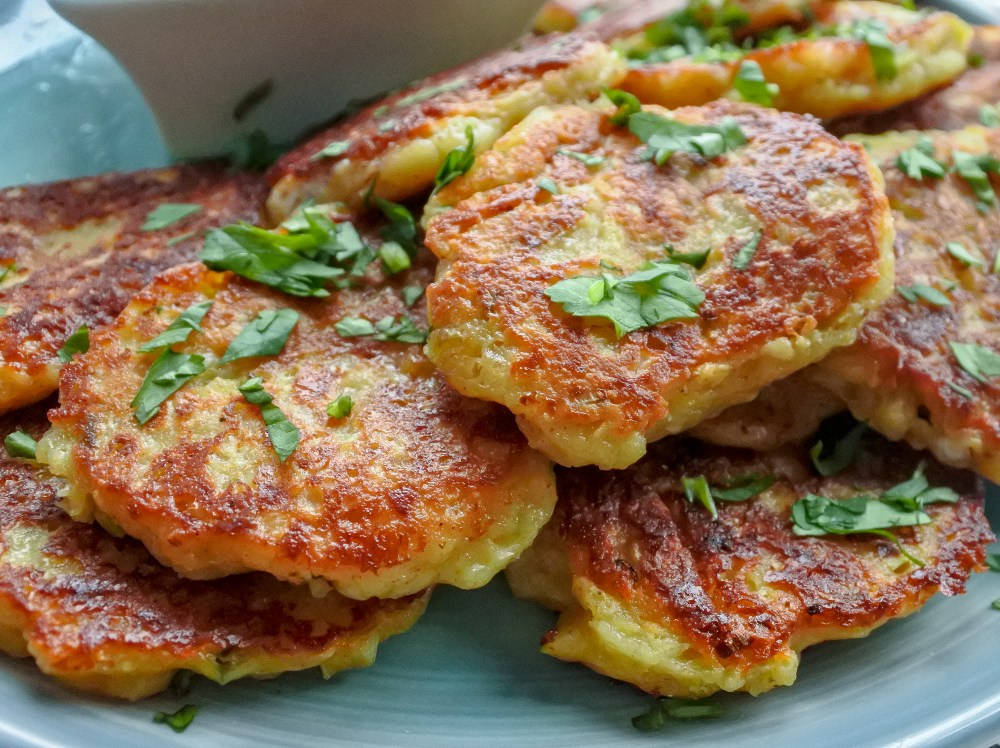 Indian spiced cheese fritters on a plate garnished with chopped cilantro