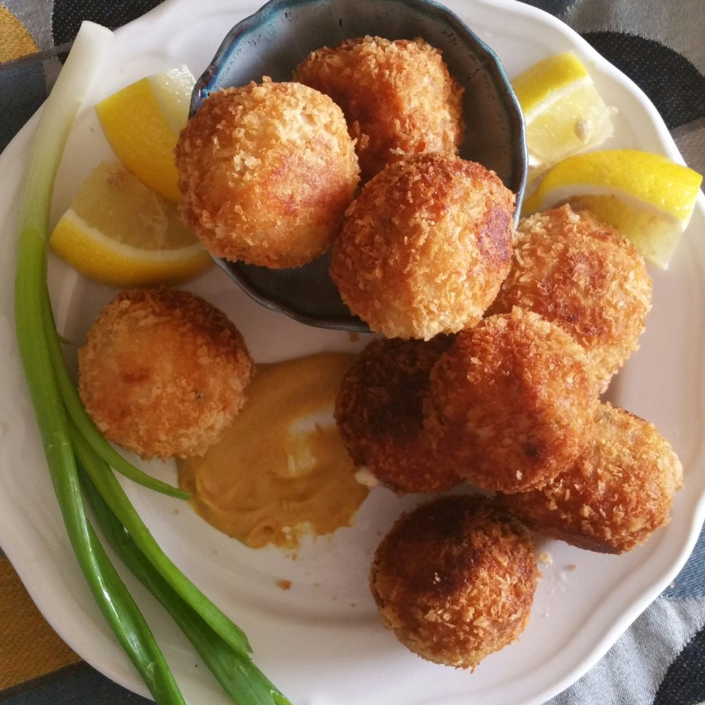 Chicken Cordon Bleu bites on a plate with mustard, lemon and scallion