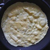 Turn heat down to low and cover omelette for 30 sec or until top of omelette is cooked