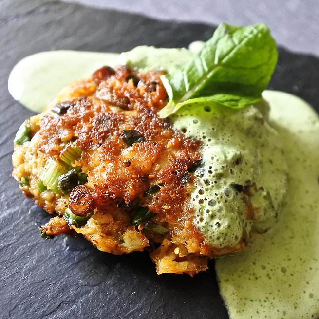 Indian spiced fish cake drizzled with a mint yogurt sauce