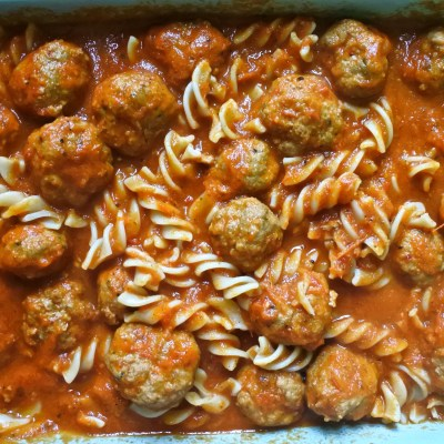 pasta, meatballs and sauce in casserole dish