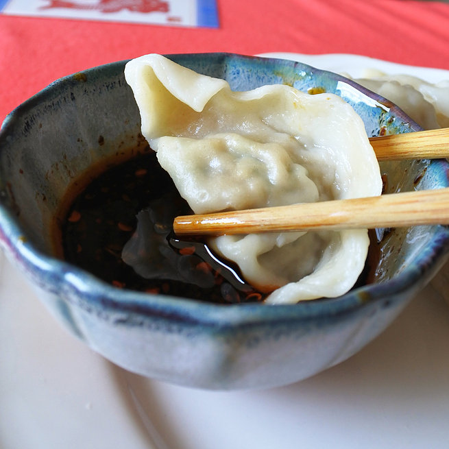 pork dumpling dipped in sauce