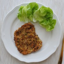 pistachio encrusted pork loin cutlet with lettuce