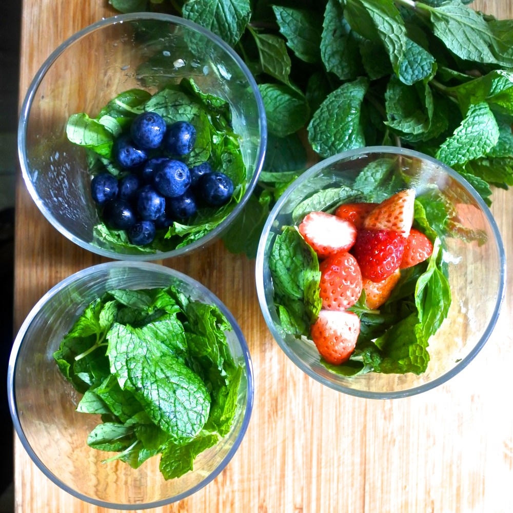 sugar, mint, lime juice and fruit in glass