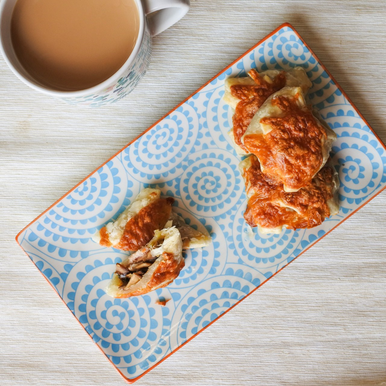 Mushrooms on Toast pastries on a plate with cup of tea